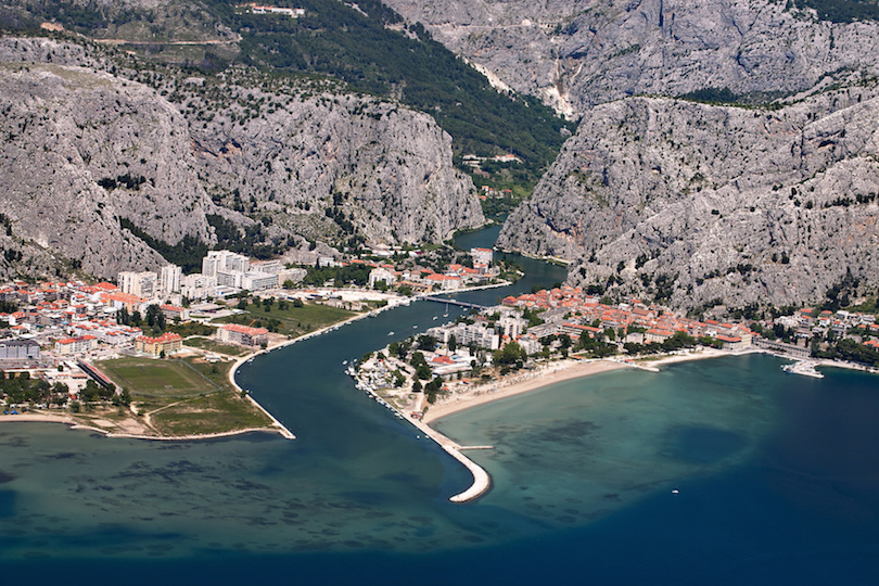 Aerial view - Omis city in Croatia. between Adriatic sea, mountain Omiska Dinara and river Cetina